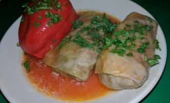 "Cabbage Rolls and Stuffed Sweet Peppers with Meat and Rice (""Golubtsi"")"
